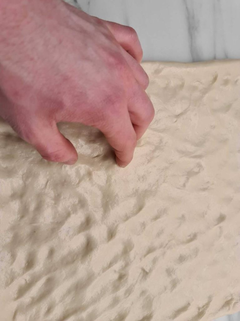 Shaping Sicilian pizza
